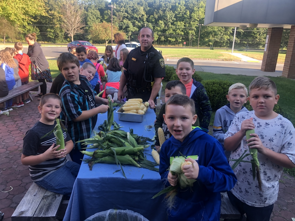 Corn shucking at BCS.