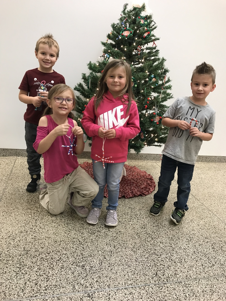 Elementary students decorating the tree.
